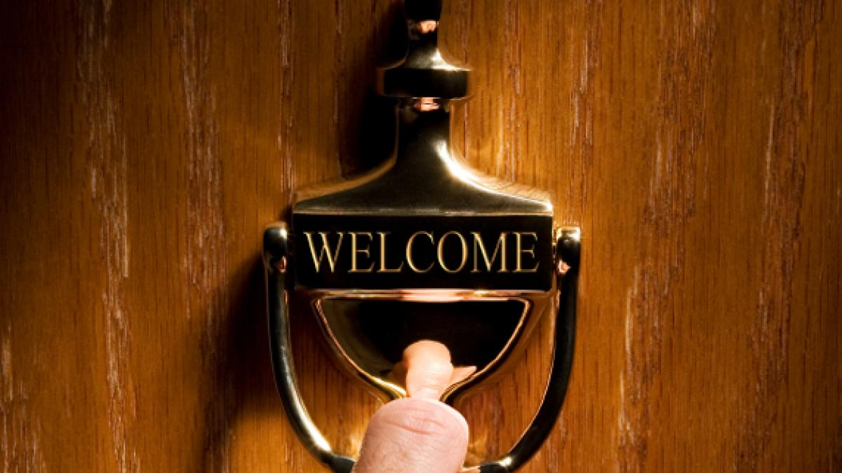 welcome sign on an office doorknocker